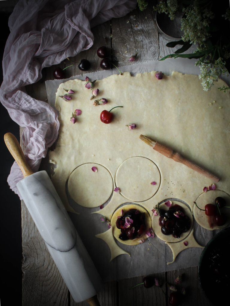 Rolling and cutting the dough for the cherry handpies