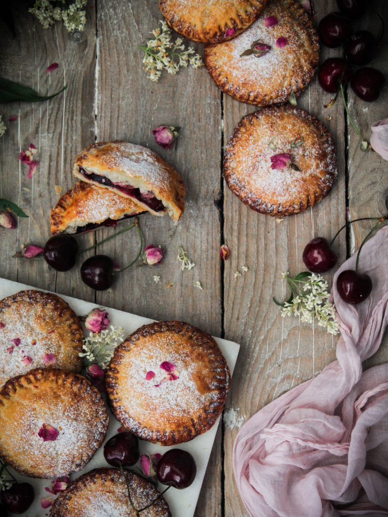 Cherry handpies on a woodboard